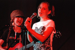 Two of the campers at a Girls Rock Camp Showcase