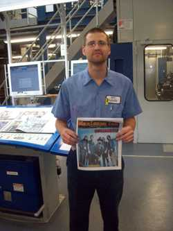Denny from Bliss Communications holds the first NEW issue of Maximum Ink to be printed on their fabulous new press