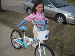 Elizabeth with her new bike from the Village Pedaler in Madison, it's her 10th b-day present - photo by Rokker