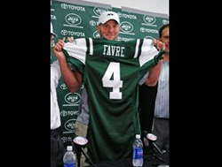 Brett Favre holding up the Jets jersey