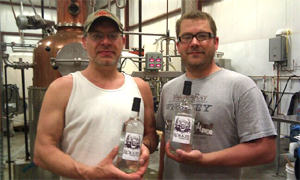 Rökker & Lars (Distiller at Yahara Bay) with the first bottles of Rökker Vodka off the line - photo by Nick Quint