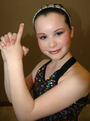 Elizabeth in her Jazz recital outfit striking her best Charlie's Angels pose