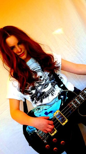 Lizzie jamming a bass guitar and new t-shirt - photo by Rökker