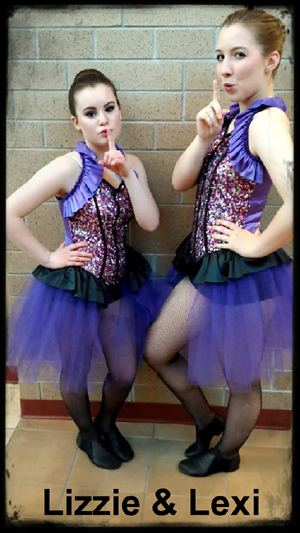 Lizzie and Lexi strinking the Angel's pose during recital break - photo by Rökker