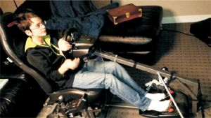 Nikko in Marko's custom Corvette seat gaming chair - photo by Mark Kroll