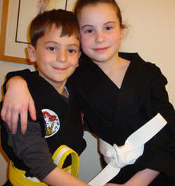 Elizabeth and Nikolai doing Karate pose - photo by Rokker