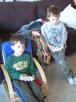 Nikko and Timmers playing Xbox 360 - photo by Rokker