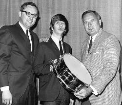 Bill Ludwig II presenting a snare drum to Ringo Star of the Beatles