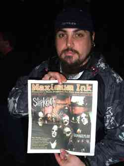 Chimaira holding the Slipknot issue of Maximum Ink
