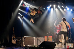Tyler Bryant jumps - photo by Andy Merrick